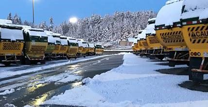 Waste Management Trucks covered in snow